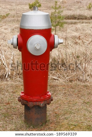 Fire hydrant closeup in rural setting. - stock photo