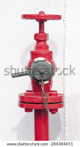 Fire hydrant detail. This fire hydrant is located in a ship.  - stock photo