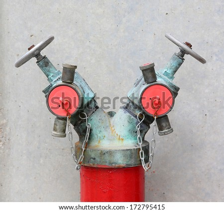 fire hydrant in front of a stone wall  - stock photo