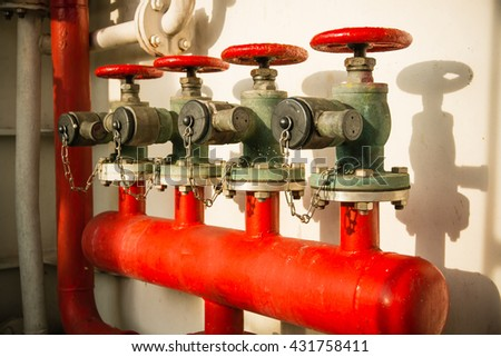 Fire hydrant manifold four outlet water valve - stock photo