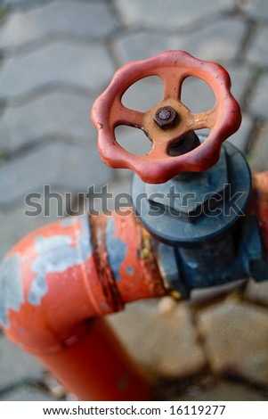 Fire hydrant tap - stock photo