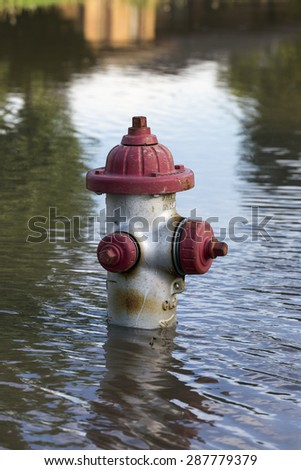 Fire Hydrant Underwater From Flooding  - stock photo