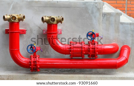 Fire Hydrants On The Wall - stock photo