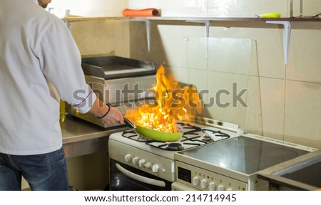 fire in a frying pan in the kitchen