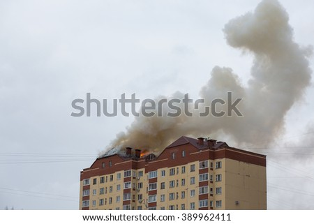 fire in a high-rise building. Russia, Ufa - March 13 2016. - stock photo