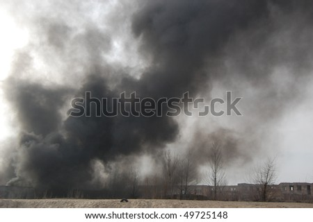Fire in abandoned industrial building. Kiev,Ukraine.March 28,2010 - stock photo