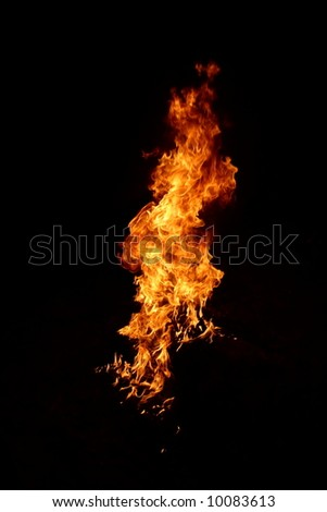 Fire in darkness - stock photo