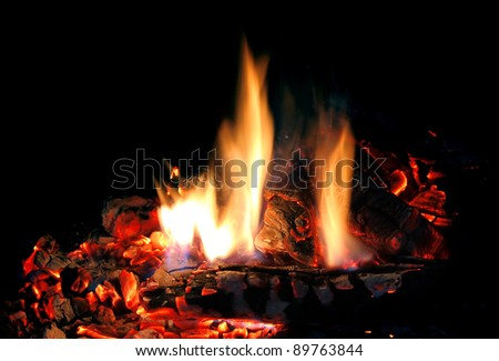 fire in fireplace isolated on black background - stock photo