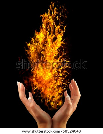 Fire in hand - stock photo