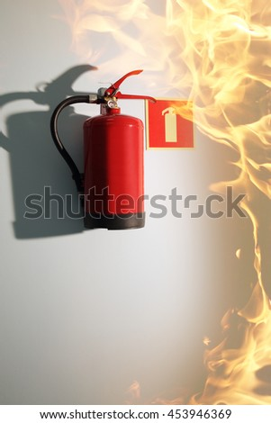 fire in the building and a fire extinguisher - stock photo