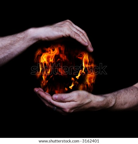 fire in the hands - stock photo