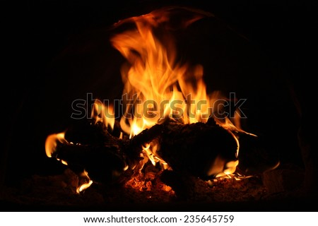 Fire in the hearth burning brightly. Traditional farmhouse fireplace. Natural photo story. Perfect illustration hot for your page magazine  - stock photo