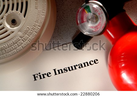 Fire insurance policy document with smoke detector and emergency extinguisher as metaphor for disaster readiness and protection - stock photo
