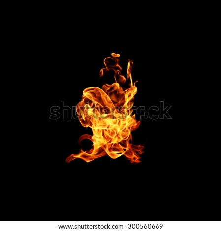 Fire isolated on black background. - stock photo