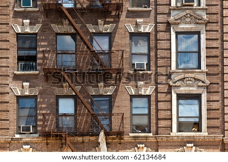 fire ladder at old beautiful houses downtown in New York - stock photo