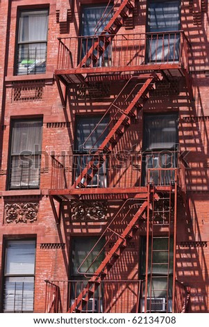 fire ladder at old beautiful houses downtown in New York