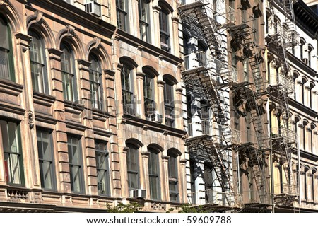 fire ladder at old houses downtown in New York - stock photo