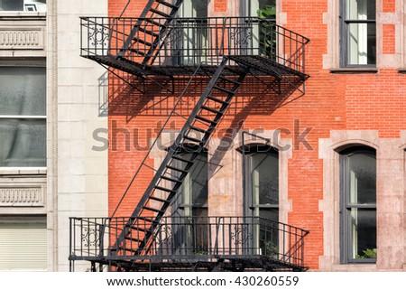 Fire ladder on New york manhattan buildings - stock photo
