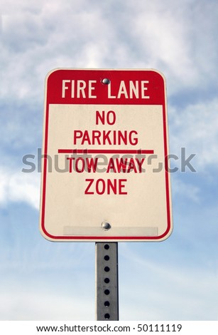 Fire Lane. No parking and tow away zone sign - stock photo
