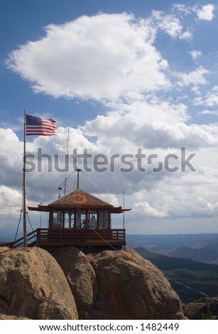 Fire lookout watchtower on top of the Devil's Head rock formation in central Colorado - stock photo