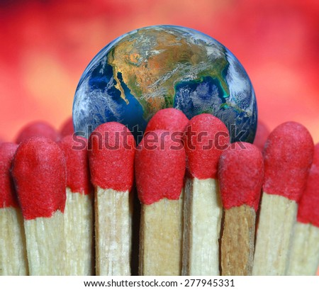 fire match and the earth,  including elements furnished by NASA. - stock photo