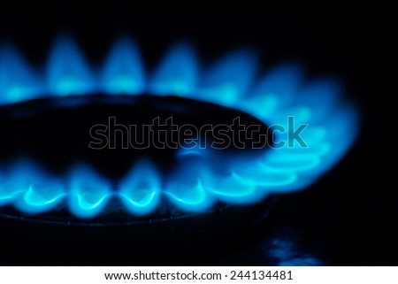 Fire natural gas burner in home on a dark background