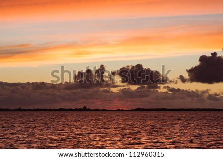 fire north sea sunset with coast line - stock photo