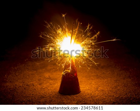 fire of cracker explosion on black background - stock photo