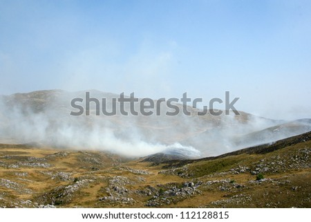 Fire of dry grass on Vlasic mountain in Bosnia and Herzegovina - stock photo