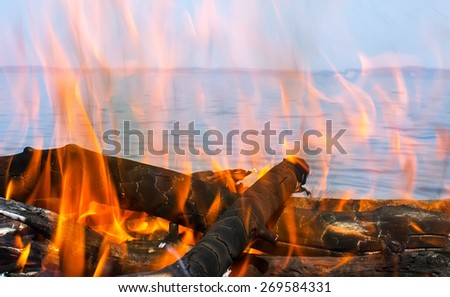 fire of wood with a sea view - stock photo