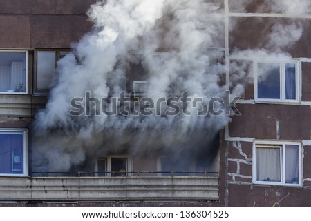 fire on balcony - stock photo
