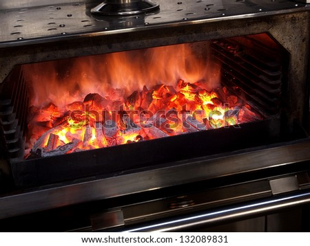 Fire on charcoal for food grilling