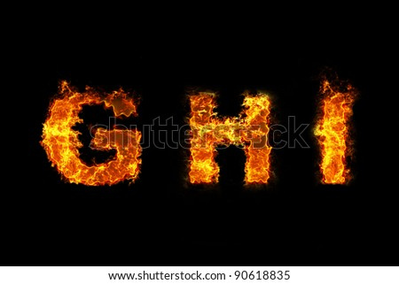 Fire on letter GHI - stock photo