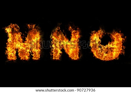 Fire on letter MNO - stock photo