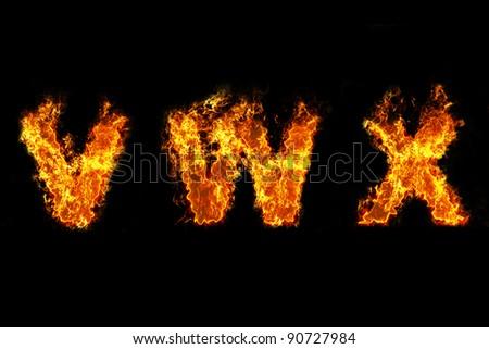 Fire on letter VWX - stock photo