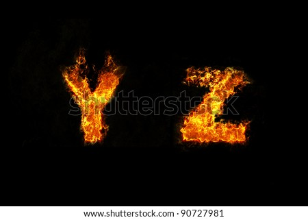 Fire on letter YZ - stock photo