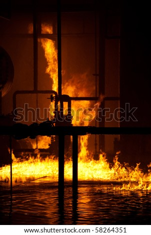fire on top of water - stock photo