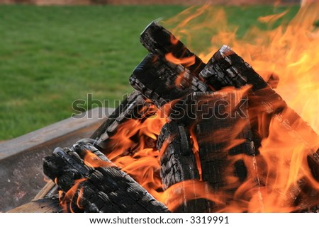 fire pit in a backyard setting with lawn - stock photo