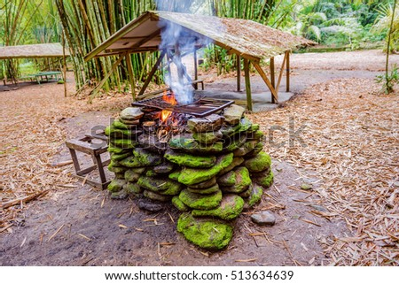 Fire pit place with stones in the jungle for barbecue outdoors camping