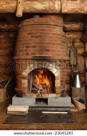 fire-place with burning firewoods - stock photo