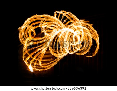 Fire Show Flaming Trails - stock photo