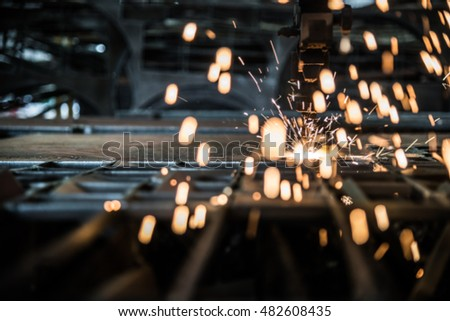 Fire spark from Plasma Cutting metal work industry machine with sparks in factory.