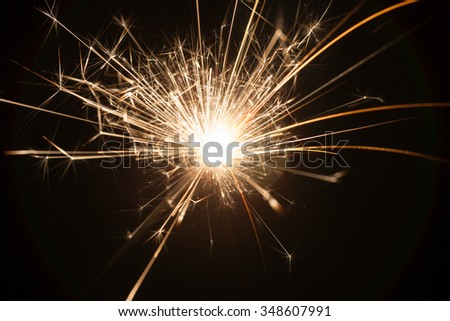 fire spark with black background studio shot - stock photo