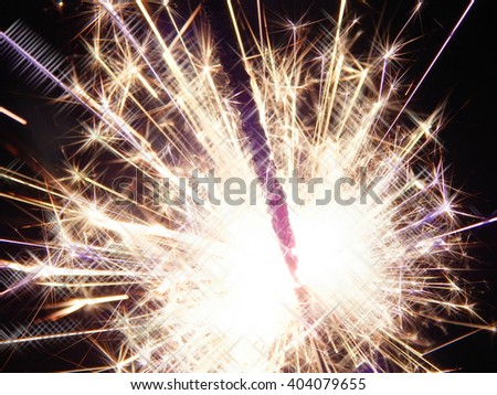 Fire sparklers on black background - stock photo