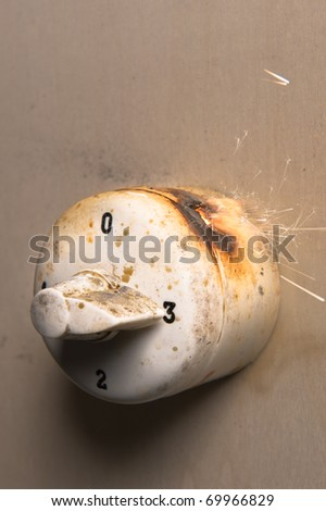 Fire starting from old switch regulator for heating-system - stock photo