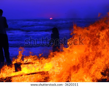 fire sunset party on the beach