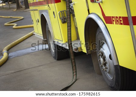 Fire Truck And Hoses - stock photo