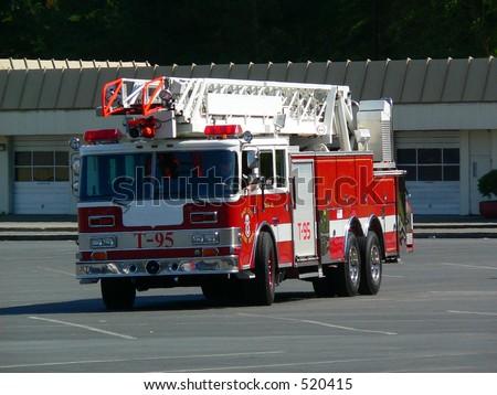Fire truck in parking lot. - stock photo