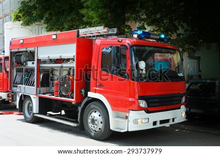 Fire Truck in situation with flashing lights - stock photo