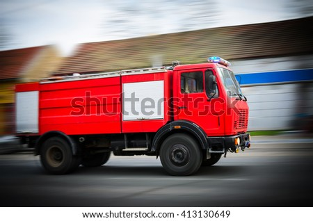 Fire Truck in situation with flashing lights, blurred motion - stock photo